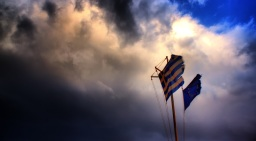Greece on Edge: Coping with Two Crises at Once